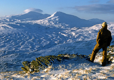 Beinn Oss and Beinn Dubhchraig.3pm, 09/01/82~ January 1982. A good winter continues. It began mild and wet at the New Year, but then became very cold from the 5th to the 15th with some record low temperatures. December's cold air was never far away, and with anticyclones in place over Greenland and Scandinavia a cold front moved south, pushed down by northeasterlies, with cold air slowly reintroduced from the 3rd, preceded by heavy rain. Between the 5th and 8th over 100 mm of rain fell on the Southern Uplands and Pennines. As the ground was frozen, it just ran off. As a result there was severe flooding in the York district when the River Ouse broke its banks after rising to 5m above normal. Ice floes became jammed under bridges. The flood waters then froze over. On the morning of the 5th there was over 40 cm of level snow at Braemar. There was more snow in the north on the 7th; and -23C at Braemar; the next day Grantown-on-Spey fell to -26.8C. The battle between very cold and mild air in the south led to blizzards; the Midlands and Wales had 30-50 cm of snow on the 8-9th with easterly gales. Many places were cut off (e.g. Torquay and Weymouth). Some drifts were 20' high. Lasting 36 hours, this was one of the most severe blizzards of the century across the Southwest and Midlands. Then with clear skies, light winds, and snow cover, Braemar fell to -27.2C (equal British record for the lowest reading) on the morning of the 10th, and logged several other very low minima that month. The maximum on the 10th was only -19.1C: a record low maximum for Britain; with a freshening easterly wind even Weymouth did not rise above -4C that day. The following day the minimum was -26.3C. There were some other very low temperatures in Scotland on the morning of the 11th, including -26.6C at Bowhill, and -26.2 at West Linton, both in the Borders. The English record was also set early in the morning of the 10th (beating that just made in December 1981!): -26.1C at Harper Adams College, just outside Newport (Shrops.). http://www.personal.dundee.ac.uk/~taharley/britweather.htm~ So it would seem the weather was even more interesting than I remember - ice floes in the Ouse - but it surely was  cold. The weekend was forecast to stay fine, and when I learned that there was to be a lunar eclipse on the Saturday evening clearly some fine plan had to be made. As I was working on Saturday morning it could be nothing elaborate or distant, and I settled on Glen Falloch and a stroll up an Caisteal with a tent and some warm gear.I set off from near Keilator farm about 1.30pm, with a sense of keen anticipation.