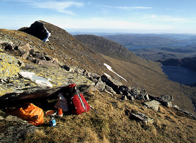 An early bivvy on Stob Daimh of Cruachan.  8pm, 02/06/79  ~ Those orange plastic bivvy sacks had the virtue of cheapness, but little else to commend them.