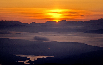 Argyllshire skyline at dawn from Beinn an Oir.  5am, 24/5/87  ~ with the sun rising in the col between Beinn an Dothaidh and Beinn Dorain.