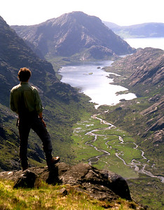 Coir'uisg and Sgurr na Stri, from halfway up to an Dorus.  8.30am, 12/06/95  ~ From an Dorus, which is not the easiest bealach to reach from the Coruisk side, I nicked up and down the west top of Mhadaidh, then proceeded uneventfully over Ghreadaidh and Banachdich to Dearg, up and down the easy side of the In. Pinn., by way of Mhic Choinnich to Alasdair, deviously around and over to Dubh Mor, and finally Eag, returning to Coruisk by way of the Garbh-choire.  Taking a decent photograph in the course of a solo day-trip along the Cuillin ridge, in uninterestingly fine weather, is not something I find easy, and this day's results are indifferent. However, I've included a few shots, which have little merit but may or may not be of interest.