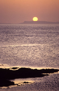 Sun setting over Colonsay, from Rubha Lang-aoinidh.  9.30pm, 24/5/87