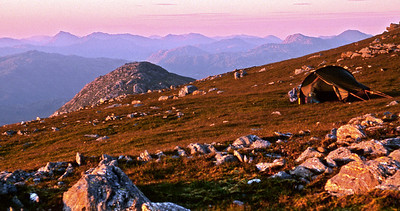 The Akto on a ruddy Rois-bheinn, just before sunset.9.50pm, 22/07/00~ Sgurr na Ciche and the Glenfinnan Sgurr nan Coireachain are the most prominent skyline peaks, an  Stac the proximate lump. With a railway station (Lochailort, Glenfinnan) at each end, and a succession of views, both montane and maritime, as fine as any in the country, the traverse of the Moidart Corbetts can give a weekend trip of rare quality, all the more so if a small tent is carried.The weather this weekend verged on the excessively good, and left me wishing I could bottle some  and keep it for later. The train got into Lochailort about 1pm, the lanes and hedges of Inverailort shimmering, and the heat as I walked sun-facing up the Coire a' Bhùiridh was merciless - I did some mental calculation and reckoned I could spare two hours  before heading over an Stac and on to Rois-bheinn in good time for the sunset, so I put up the Akto pro tem., splashed it and myself with water, and crawled into its shade.An Stac at 6.30, the tent up on Rois-bheinn by 8, and all was well with the world.I'd hoped to get moving seriously early the next morning, in self-defence, and 6.30 was far too late, but  luckily a sheet of high cloud was filtering out most of the direct sunlight, which made for delightful progress. However, by Druim Fiaclach this had more or less burnt off, and from there on it was a purgatory-in-paradise, over Beinn Mhic Cèdidh and on to the Beinn Odhars.The details of how I got down to Glenfinnan are lost in a haze  of heat, but I suspect, since the easiest descent involves a final 3 miles of road to the station, that I went down the Coire Odhar, over by Lochan nan Sleubhaich and down by the Allt na h-Aire. The crossing of the Abhainn Shlatach must have been easy as I have no memory of it either, but one thing I do recall is being profoundly grateful that I didn't have to drive back to Glasgow.