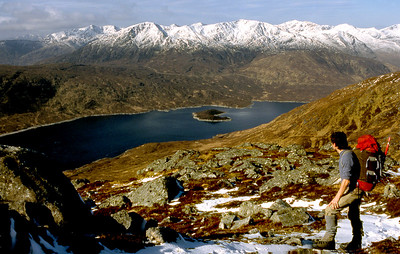 Retrospect from the Carn Ghluasaid path.  11am, 21/4/85   ~ This was a simple two-day trip - from Loch Cluanie over to Glen Affric, a night in a bothy, and back again. Nothing very significant or memorable happened, but it was full of small pleasures and I recall it with the greatest affection. Spring weather at its vibrant best graced the first day, by this splendid stalkers' path on to Carn Ghluasaid, then over Conbhairean and Sail Chaorainn and out to Tigh Mor. The conditions, better conveyed by the photographs than in words, made it an easy decision to stay high and take in the Corbett of Carn a'Choire Ghairbh before picking up the path down by the Allt Garbh to White Cottage.  The next morning was still and overcast, and with a better than even-money chance of an inversion (I thought) I set off early with high hopes, trotting down to Gleann na Ciche  and up on to the Mullach by the shorter of its NE ridges. Sadly, if there was an inversion its ceiling was well above 1100m, and I never got a sniff of a view on the ridge to a'Chralaig, or until well down its SE shoulder. Ah well, can't win 'em all.
