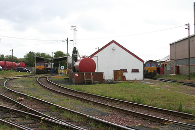 Fule roads to left with depot buildings to centre