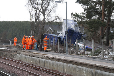 Containers in a heap at Carrbridge as the recovery squad look on