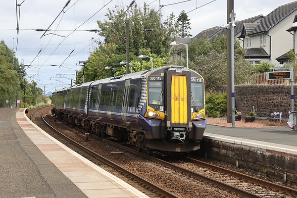 380115 passes Kirknewton with 1Y83 1252 EDB - GLC running 6E 28th July 2020. Checked at Midcalder Jn to allow 1S46 priority.