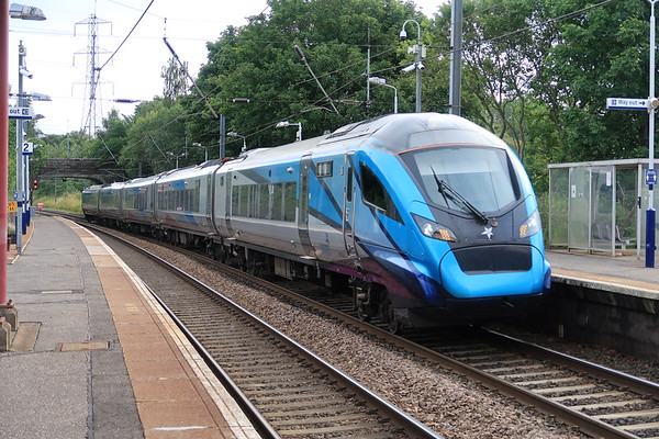 397004 passes Curriehill on the 0812 Edinburgh - Manchester Airport service 24th July 2020