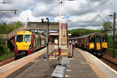 334036 and 318266 at Hyndland.   The bridge and underpass connect housing to the left with Gartnavel Hospital to the right.