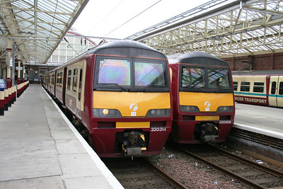 320308 and 320314 at Helensburgh Central