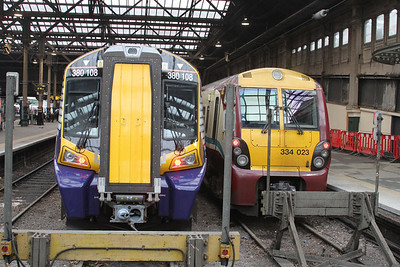 380108 and 334023 at Waverley