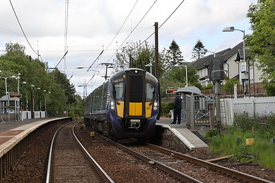 385038 at Kirknewton. The crossing barriers are proving a problem and I'm able to take this shot as they are open.