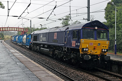 66109 looking suitably damp on 4E96 Grangemouth - Tees at Curriehill 22nd July 2020