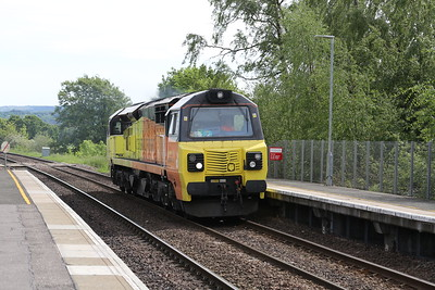 70802 roars through Bridge of Allan for Aberdeen Craiginches on Sunday 28th May  as 0Z60 to rescue a failed 60 and cement empties