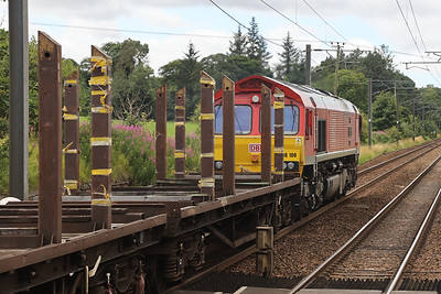 66100 passes Kirknewton with 6S88 (probably) 0543 Tees - Mossend empty BTAs (pipe) 28th July 2020