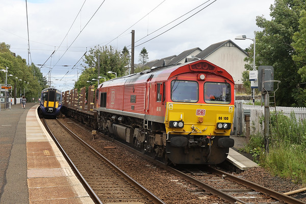 66100 passes Kirknewton with 6S88 (probably) 0543 Tees - Mossend empty BTAs (pipe). Partial bowl out by the 385. 28th July 2020