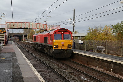 66149 runs light through Whifflet from   Grangemouth TDG - Mossend 19th November 2019 in the path of the Grangemouth - Mossend Intermodal