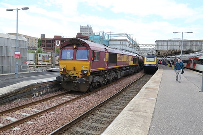 66067 waits patiently with 6D84 Aberdeen Waterloo - Mossend empty formerly silver bullets
