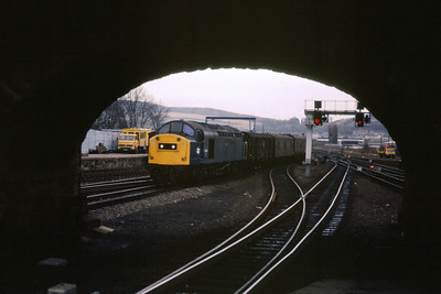 40065 is framed by the overbridge as she takes the Aberdeen road at Perth with a parcels