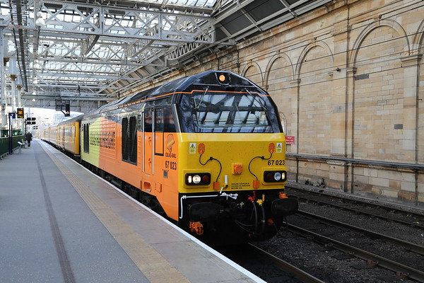 67023 leads 1Q24 for Newcastle via Glasgow Queen St...67027 on the rear