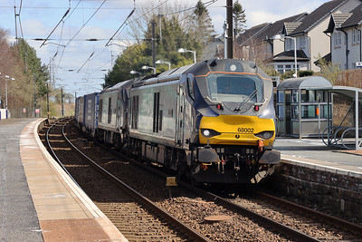 68002 Intrepid and 68005 Defiant pick up the pace through Kirknewton on a Daventry - Mossend service diverted via the ECML. Easter Monday 5th April 2021