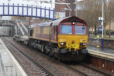 66187 is 4D51 1043 Grangemouth TDG to Mossend passing Falkirk Grahamston in a hail shower 12th March 2021