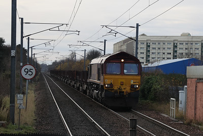 66079 slowly past Kingsknowe with 6E30 Dalzell - Tees steel empties 27th Nov 2020