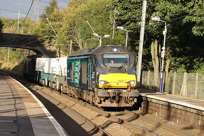 68017 top and tail with 68018 hammers through Curriehill with 6M50 Torness flasks 1st October 2020