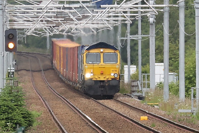 66740 lost in the haze approaching Livingston South with 4S69 Doncaster iPort - Elderslie 6th July 2021