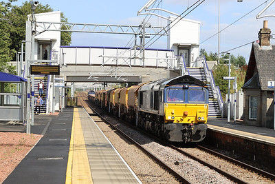 66431 leads 66303 through West Calder with a Millerhill to Muirend run 14th August 2021