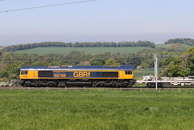 667788 brings top the rear of a much delayed 6X06 1115 Shieldmuir to Millerhill past Kirknewton 31st May 2021.