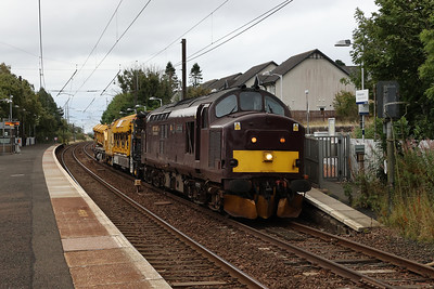 37685 passes Kirknewton with the Railvac and a ballast unloader as 6X25 Millerhill to Connel Ferry (No Ferry) on 22nd September 2021
