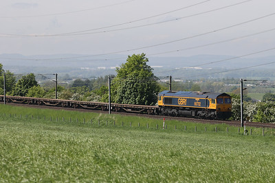 66702 leads a much delayed 6X06 1115 Shieldmuir to Millerhill past Kirknewton 31st May 2021.  66788 brings up the rear.