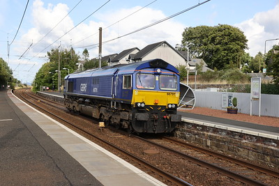 66791 in Beacon Rail Livery passes Kirknewton with 0G66 Craigentinny - Mossend as part of a loco swop 28th July 2021