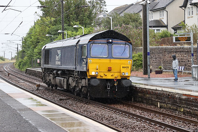 66425 returns light to Motherwell having deposited 66424 at Craigentinny. Cold wet and windy Kirknewton 4th August 2020
