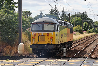 56049 Robin of Templecombe passes Kirknewton with the 1400 Millerhill - Grangemouth Ineos - 38 early. 2nd August 2021