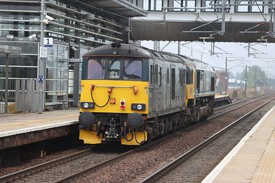 66789 drags an errant 73967 from Carrbridge to Craigentinny through Edinburgh Park 9th September 2021