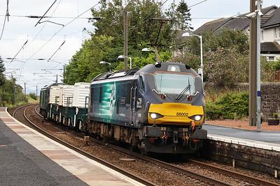 88002 leads 68017 through Kirknewton on 6M50 Torness - Carlisle mystery cargo 5th August 2020