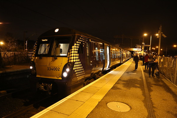 334002 was 2H10 2026 Helensburgh Central to Edinburgh but was terminated at Airdrie as a result of deliberate fire damage to signal cabling at Blackridge 180117.    Buses forward to Livi North for train to Edinburgh but I opted for a seat in a taxi.   Still an hour late home on that basis - I shudder to think how long it would have taken had I got the bus....