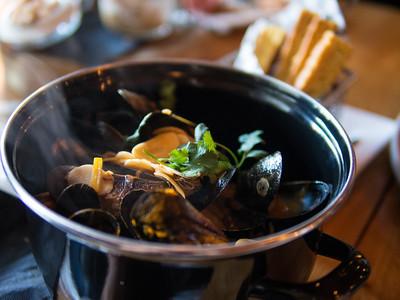 Saltspring mussels, tomato coconut broth, cornbread biscotti