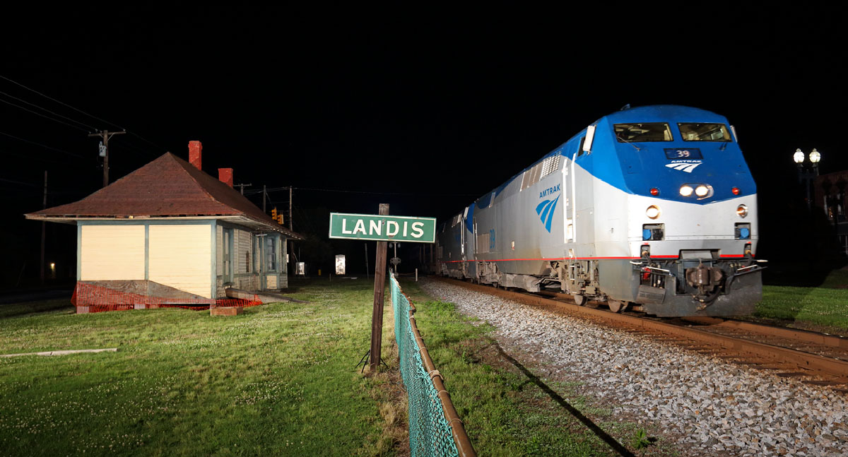 The southbound Amtrak Crescent passing the  Landis,NC Southern Railway Depot.