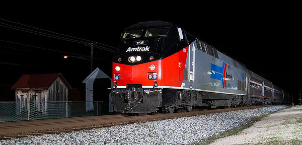 Amtrak 40th Anniversary motor #156 in the Amtrak Phase I paint scheme leads the southbound Amtrak Crescent thru Landis,NC.
