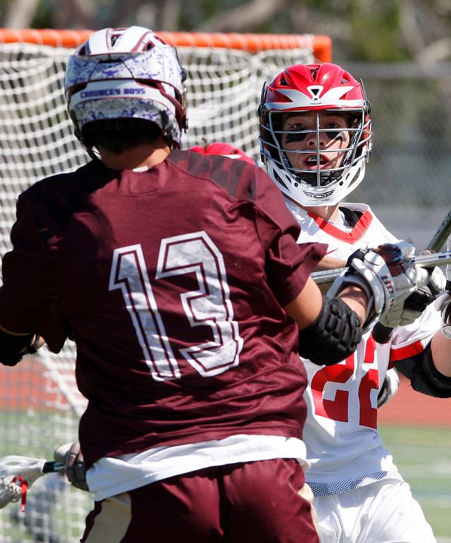 . Scotts Valley\'s Josh Eskew (13) takes a shot on goal past Carmel\'s Jake Burke (22) during the MTAL lacrosse championship in Carmel on Friday, May 12, 2017.  (Vern Fisher - Monterey Herald)