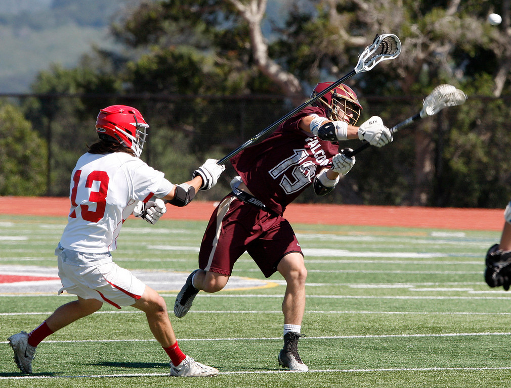 . Carmel\'s Emerson Hardy (13) tries to block a shot from Scotts Valley\'s Baxter Wesson (19) during the MTAL lacrosse championship in Carmel on Friday, May 12, 2017.  (Vern Fisher - Monterey Herald)