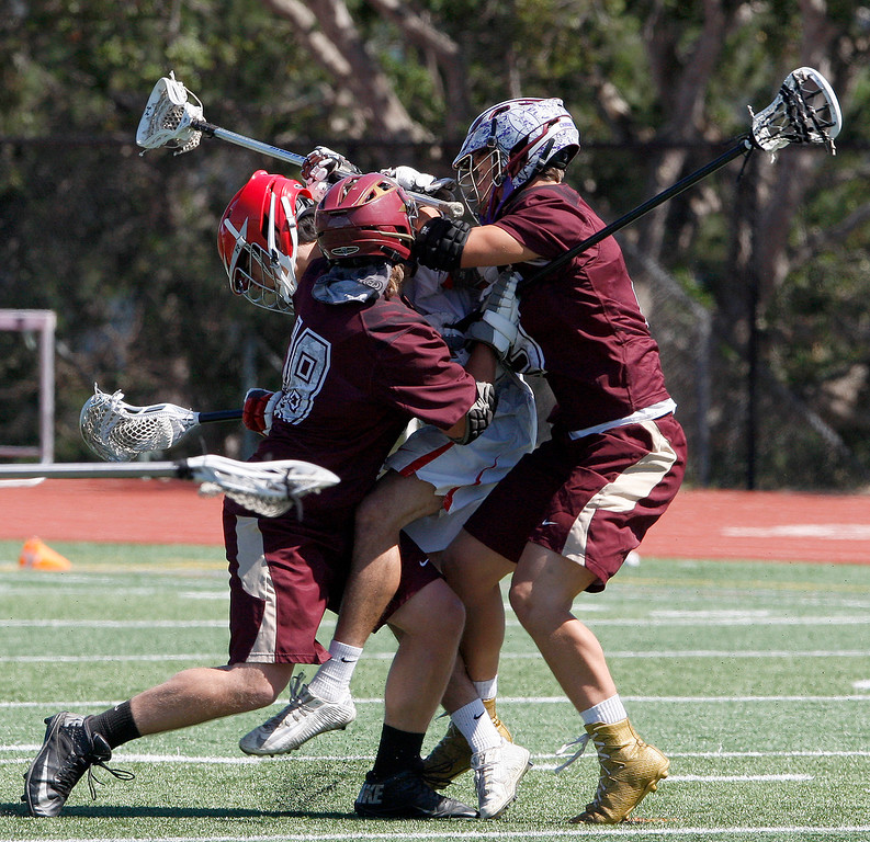 . Scotts Valley\'s Cooper Rains (18) and Josh Eskew (13) crush Carmel\'s Kenshi Husted (27) during the MTAL lacrosse championship in Carmel on Friday, May 12, 2017.  (Vern Fisher - Monterey Herald)