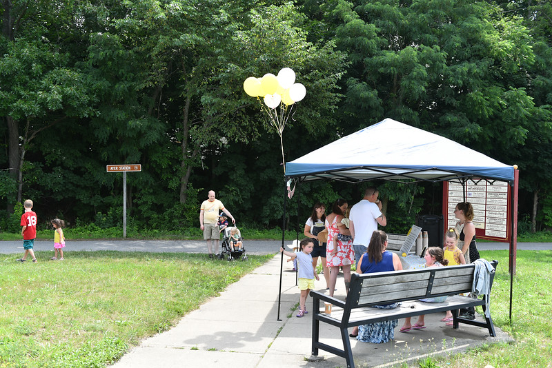 Scout Maloney, of Ayer sells Lemonade at the Ayer end of the Nashua River Rail Trail on Sunday to raise money for immigrant children on the border.  SENTINEL & ENTERPRISE JEFF PORTER