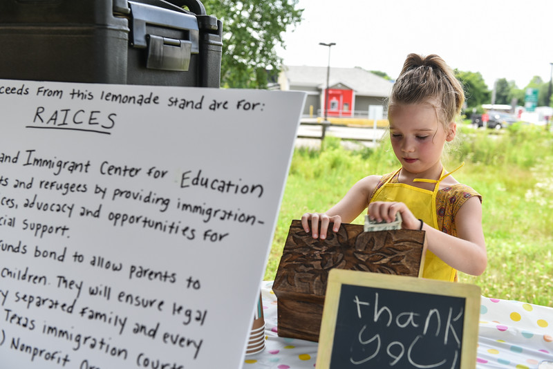 Scout Maloney, 7, of Ayer sells lemonade at the Ayer end of the Nashua River Rail Trail on Sunday to raise money for immigrant children on the border.  SENTINEL & ENTERPRISE JEFF PORTER