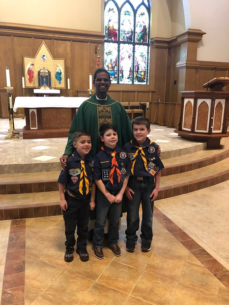 James Amodio, Jr.  and Liam Richardson, Daniel McCartney, Pack 77 Members, receive the Light of Christ Award from Fr. Pancrose during the Scout Sunday Mass February  10, 2019