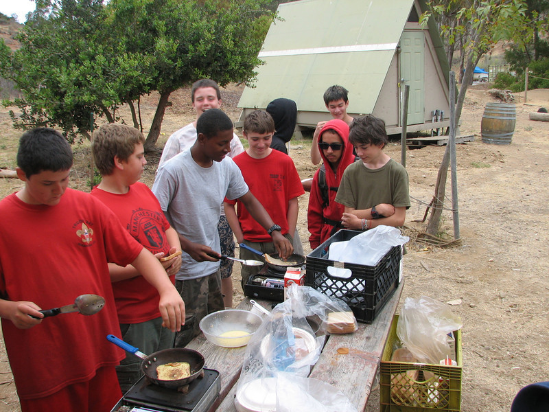 Camping Merit Badge requires cooking a hot meal during a campout. Here the boys take turns burning -- er, cooking -- french toast and bacon for their breakfast. They only had 2 burners available for all those boys, so this process took a while. And they didn't have proper spatulas, so they had to use big spoons.