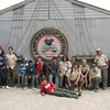 Troop picture in front of this great emblem on the side of the maintenance building.
