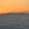 As the sun got closer to rising, we started to see these shadows of the mountains appear in the sky above them.